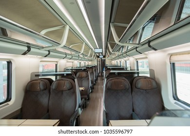 Interior of the European car of the intercity train with sedentary places
