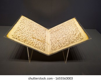 Interior, exposition of Museum of Islamic Science and Art. Ancient open books with pages yellow from old age, illustrations, inscriptions in ancient Arabic or Persian. Turkey, Istanbul, February 2020