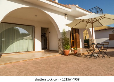 Interior and exterior design of a mediterranean villa with terraces outside and vitage furniture style