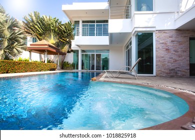 Interior and exterior design of pool villa which features living area, greenery garden, pavilion and swimming pool home, house ,building