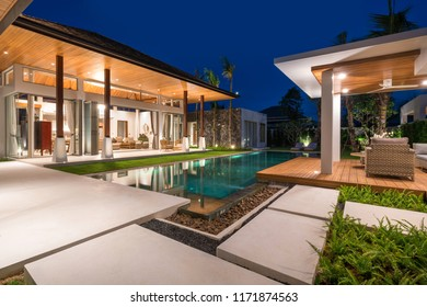 Interior and exterior design of pool villa with swimming pool home, house , building , hotel, resort night time