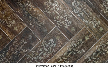 Interior or exterior vintage bathroom or kitchen square ceramic tiles. Image of retro interior flooring with brown pavement slabs with floral decoration and flower motives.