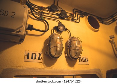 """interior of the fallout bunker - lamps and information boards """"go"""" and """"stand"""""""