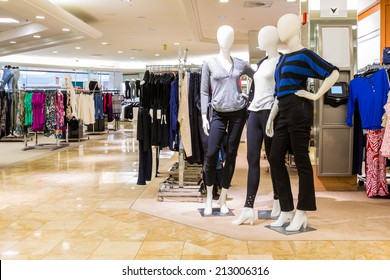 Interior of a fashion and designer clothing store.