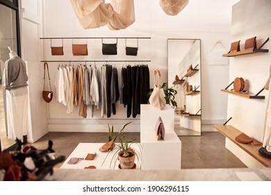 Interior of a fashionable clothing boutique full of an assortment of bags and accessories on display