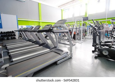 Interior of a fitness hall with treadmills