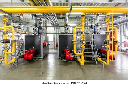 The interior of gas boiler, with three boilers.