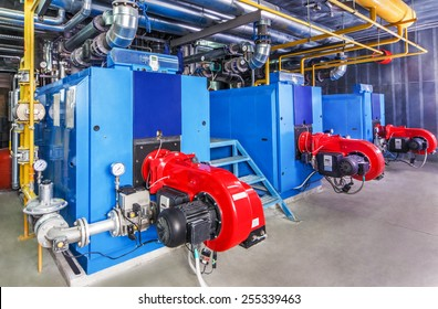Interior gas boiler with three boilers.