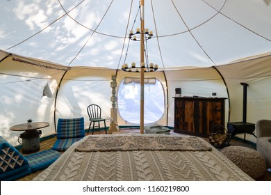 Interior of a glamping tent in a forest