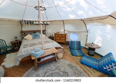 The interior of a glamping tent in a forest in Ontario, Canada.