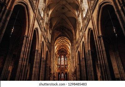 Interior of Gothic Cathedral inside. Carved pulpit, stained-glass Windows through which light rays penetrate building Prague, Czech Republic