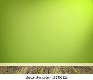 Interior with green wall and wooden floor