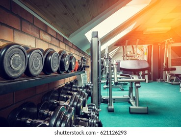 Interior of the gym. In the foreground dumbbell row