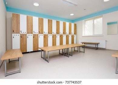 Interior of gym locker room, brown, blue and white colored