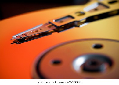 Interior of a Hard Disk Drive with Orange Lighting