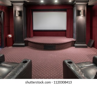 Interior of home theater in residential setting with blank screen