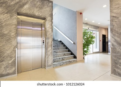 Interior of a hotel lobby elevator and marble stairs