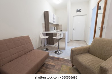 Interior of a hotel room with kitchen