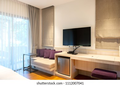 Interior hotel room with LED television and  window blinds