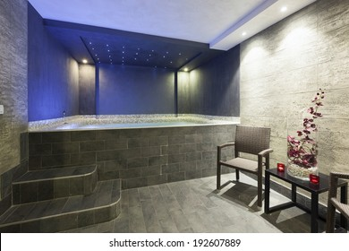 Interior of a hotel spa with jacuzzi bath with ambient led lights