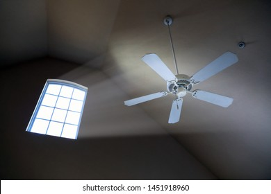 interior of house with close up ceiling fan and window