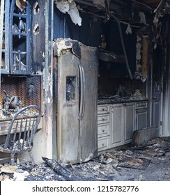 The interior of a house has been fully destroyed by a fire.