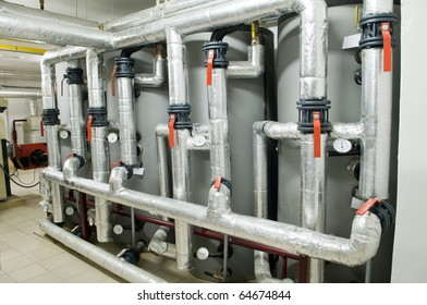 Interior of independent  modern gas boiler room with manometers and thermo-insulation on pipelines