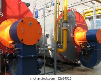 Interior of independent modern gas boiler-house with two steel boilers