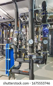 interior of an industrial boiler house, technological unit with many sensors, indicators and valves.