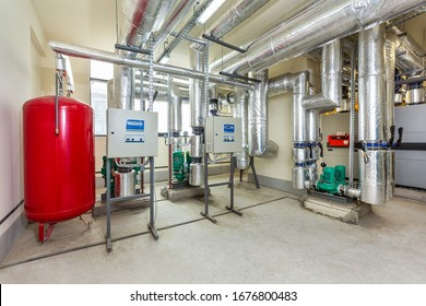 interior of an industrial boiler room, automatic control panel with many sensors, indicators and valves.