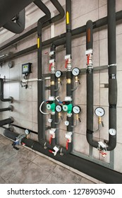 interior of industrial, gas boiler room with boilers; pumps; sensors and a variety of pipelines.
