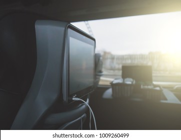 Interior inside of modern bus with monitor.