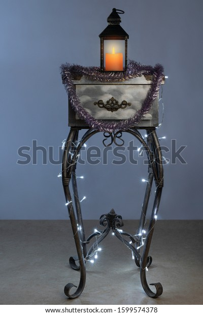 Interior item, old table, bedside table with Christmas decoration