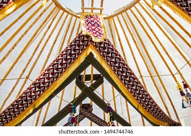 Interior of Kazakh yurt. Zhelbau - fixing ribbons, shangyrak (crown of yurt) & magic tassels (against evil eye)