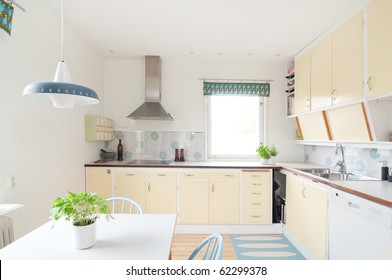 interior of a kitchen in 50s style and yellow cupboards