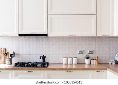 Interior kitchen design details - modern cabinets and wooden furniture