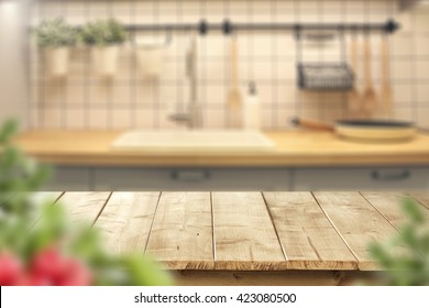 interior of kitchen and desk and leaves