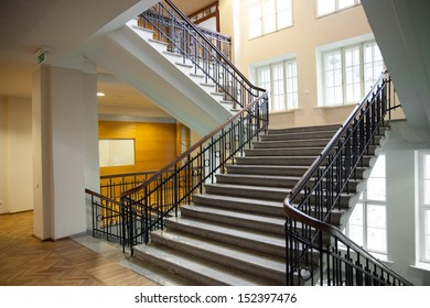 Interior of a large building with old stairway