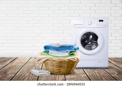 Interior of laundry room with a washing machine on wall background.