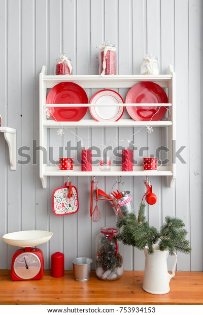 Interior light grey kitchen and red christmas decor. Preparing lunch at home on the kitchen concept