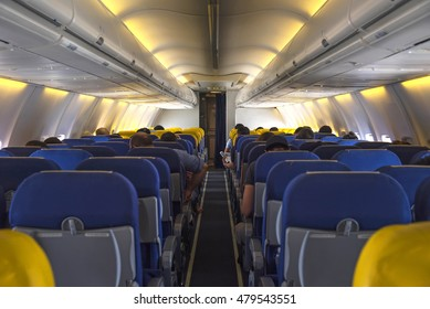 Interior lights of aeroplane or airplane with passengers on seats waiting plan to taik off.