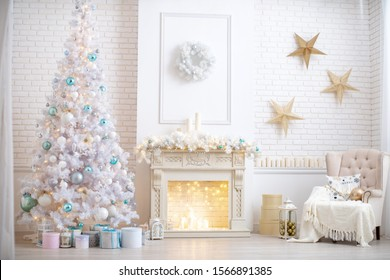 the interior of the living room in bright colors, decorated for Christmas. high and fluffy white Christmas tree next to the fireplace decorated with garland and wink. light chair by the window