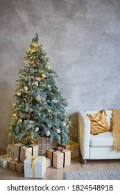 Interior of living room with Chistmas tree, gift boxes and white sofa