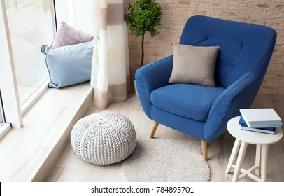 Interior of living room with comfortable armchair
