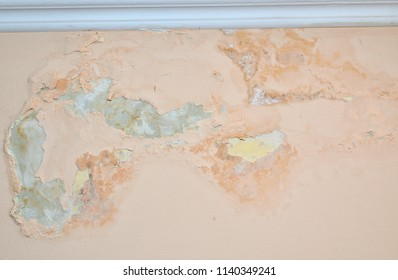 Interior of a living room damaged by moisture