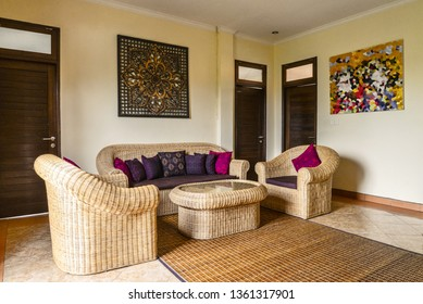 Interior of living room in house for rent in traditional balinese style. On the wall digitaly generated pic by me.