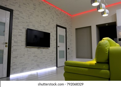 the interior of the living room with a led tape