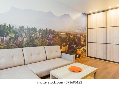 The interior of the living room in orange tones with sofa