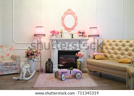 The Interior Of The Living Room In A Romantic Style With A Fireplace, Two  Pink