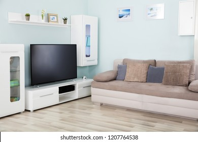 Interior Of A Living Room With Television And Furniture